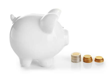 Piggy bank with coins, isolated on white