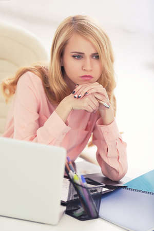Tired woman at the laptop in office
