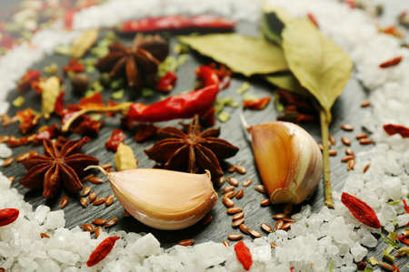 Different spices on wooden table, closeup