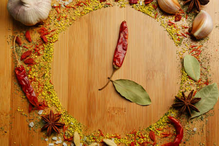 Style clock of spices on cutting board