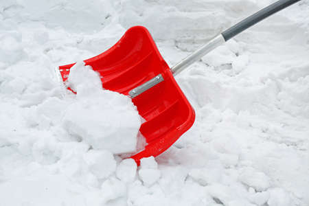 Red shovel for snow removal