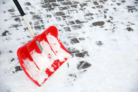 Red plastic shovel for snow Stock Photo