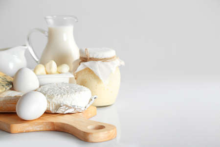 Set of fresh dairy products on wooden table, on white background