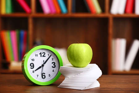 Apple and paper on table in the room Stock Photo
