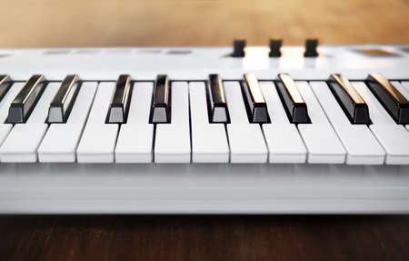 A musical keyboard depressible levers synthesizer closeup Stock Photo
