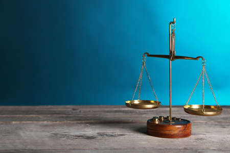 Justice scales on blue background Stock Photo