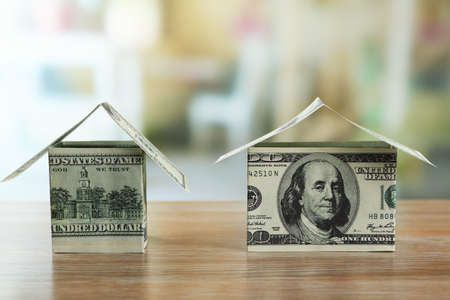 Money house on wooden table, close up Stock Photo