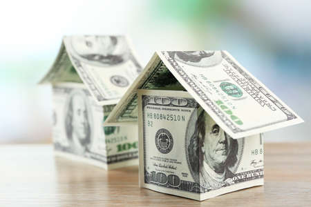 Money houses on wooden table, close up Stock Photo