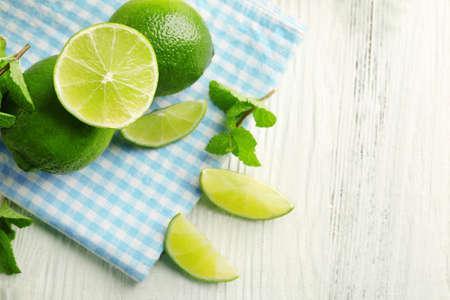 Fresh limes on blue napkin Stock Photo