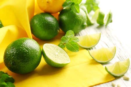 Fresh limes on yellow napkin