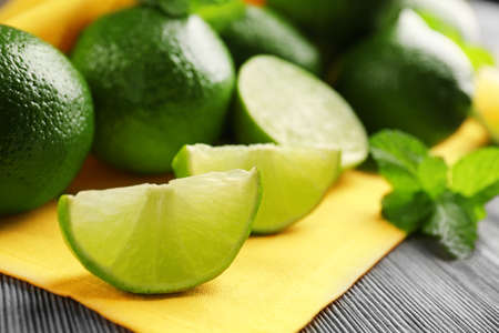 Fresh limes and mint on yellow napkin