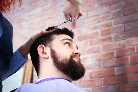 Handsome man visit barber shop