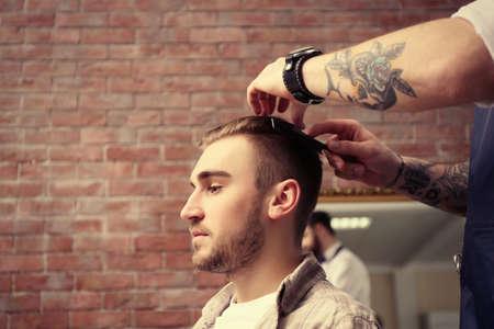 Handsome man visit barber shop