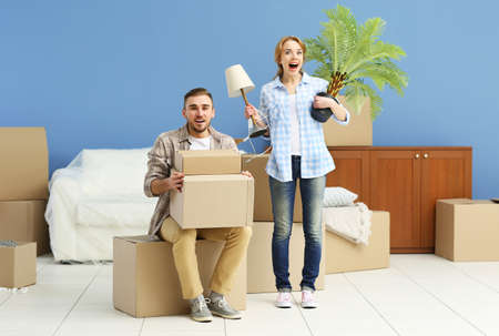 Happy young couple moving in their new apartment