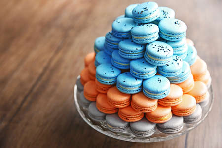 Many varicolored tasty macaroons on a dish