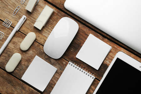 Set of office stationery with a computer on a wooden background Stockfoto