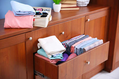 Neatly folded clothes in wooden drawer Reklamní fotografie