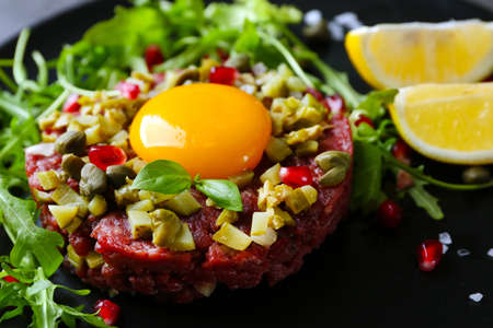Beef tartare served in a round plate, close up Stock Photo