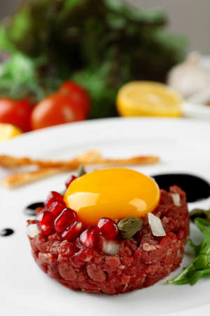 Beef tartare served on a plate, close up Stock Photo