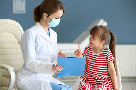 Doctor and little girl in the office Stock Photo