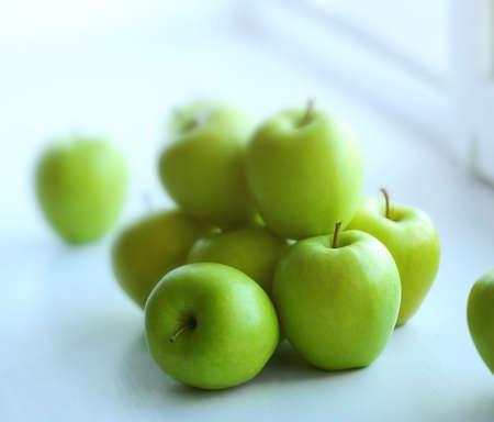 Ripe green apples on a windowsill