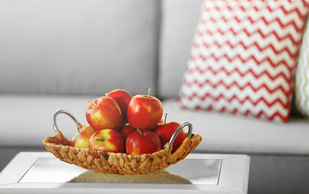 Ripe red apples on a table in the room Stock Photo