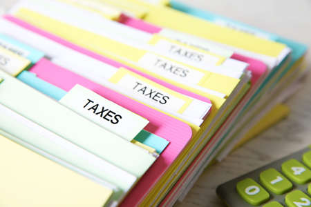 Folders with tax documents and calculator