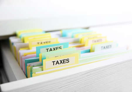 Open drawer with variety of tax documents
