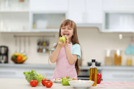 Little girl holding a green pepper.