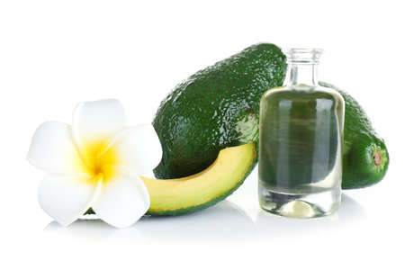 Avocado, plumeria and oil, isolated on white background Banque d'images