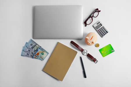 Business concept. Tablet, money, watch, eyeglasses on white background Foto de archivo