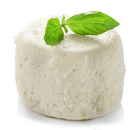 Cottage cheese with basil, isolated on white background Reklamní fotografie