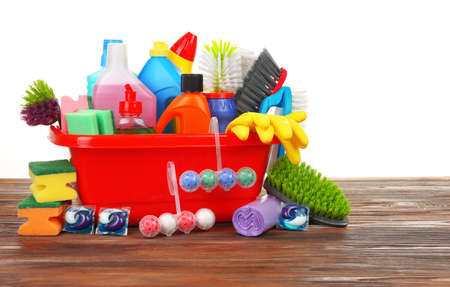Basin of cleaning supplies on the floor Stock Photo