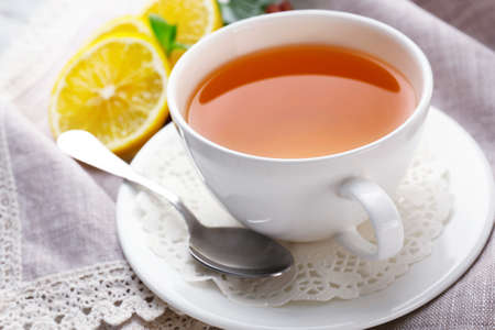 Cup of tea with ginger on napkin Stock Photo