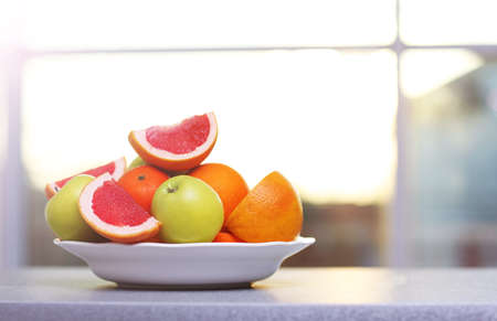 Plate of ripe fruits on a table
