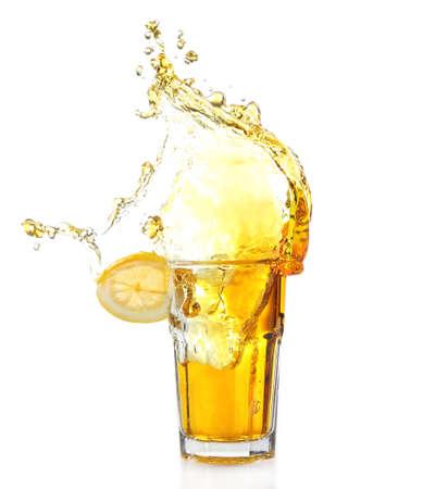 Ice tea with lemon splash, isolated on white background