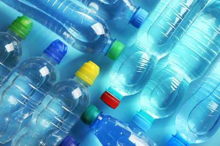 Bottled water on the blue background,top view Stock Photo
