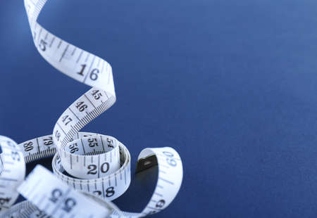 White measuring tape on a black background Stock Photo - 95665173
