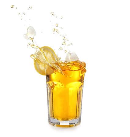 Ice tea with lemon splash, isolated on white