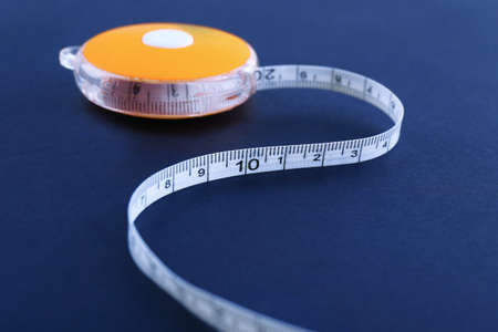 White measuring tape on a black background