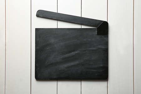 Movie clapperboard on wooden background