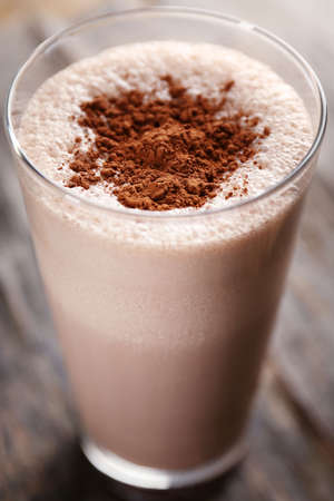 Delicious milk cocktail on rustic background, close up Stock Photo