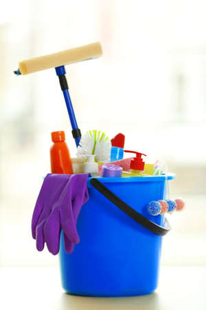 Cleaning set with products and tools in blue bucket Stock Photo