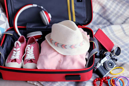 Woman's clothes in a red suitcase, close up Stockfoto