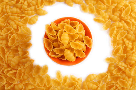 Pile of Italian dry pasta in a bowl, top view Stock Photo