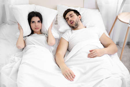 Young girl cant sleep because of her mans snoring.