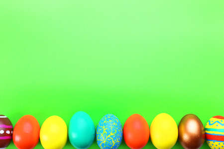 Easter eggs on green background Stock Photo