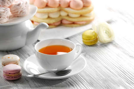 Cup of tea with delicious cakes Stockfoto