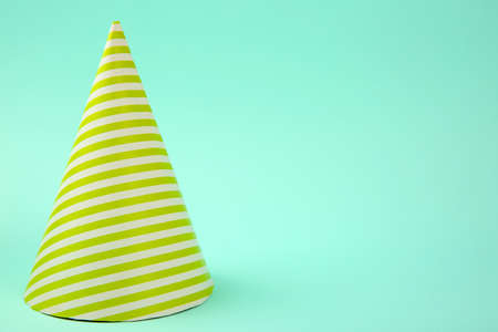 Striped Birthday hat on light blue background Фото со стока
