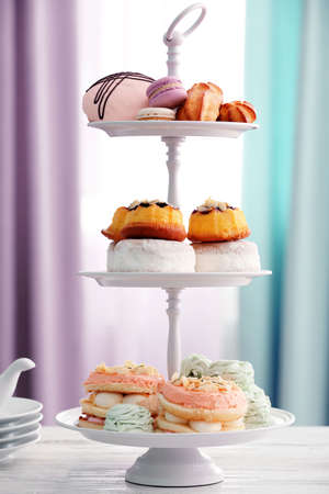 Cake stand with different sweets Stock Photo